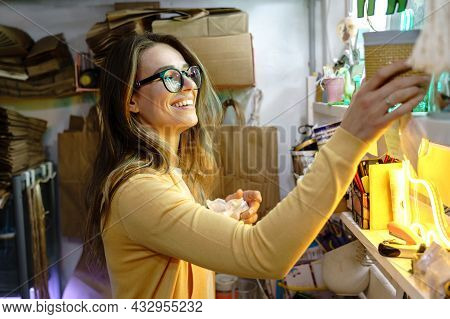 Self-employed Young Businesswoman Choosing Package For Packing And Sending Client Order From Online