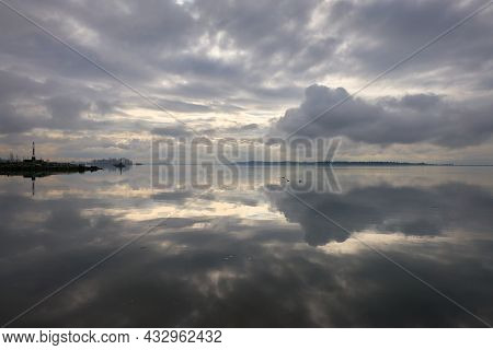 Garry Point Fraser River Reflection. Early Morning Calm On The Fraser River, British Columbia.