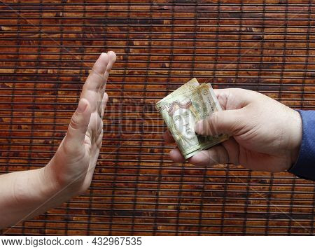 Hand Of A Person Giving Peruvian Money And Hand Of Another Person Rejecting