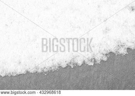 Icy Fuzzy White Snow Covered On The Grey Rough Surface Floor. Abstract Background In Winter Season,