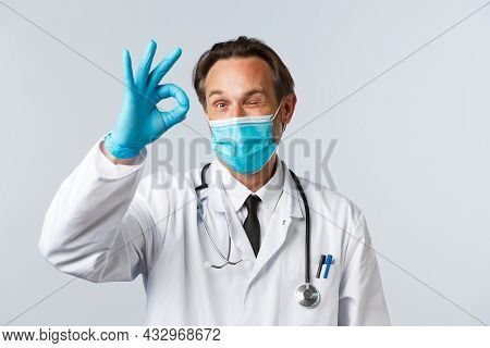 Covid-19, Preventing Virus, Healthcare Workers And Vaccination Concept. Cheerful Satisfied Doctor In
