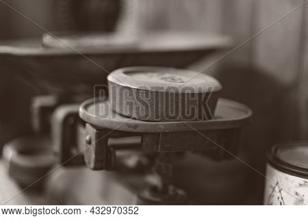 Vintage Weights For Weighing Produce In A Shop - Monotone Image In Shallow Depth Of Field
