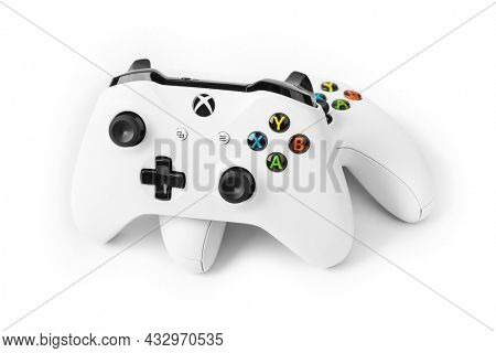 Moscow, Russia - April 18, 2019: Wireless gamepads for Xbox console - isolated on white background.