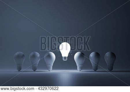 Light Bulb Bright Outstanding Among Lightbulb On White Background. Concept Of Creative Idea And Insp