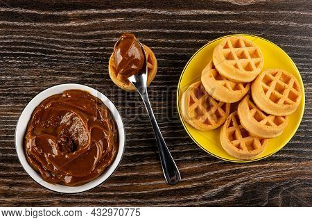 White Bowl With Boiled Condensed Milk, Teaspoon With Boiled Condensed Milk On Waffle, Yellow Saucer