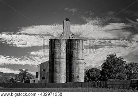 Grain Storage Silos For Grain Production By Farmers Before Going To Market, In Monotone
