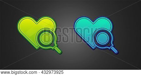 Green And Blue Medical Heart Inspection Icon Isolated On Black Background. Heart Magnifier Search. V