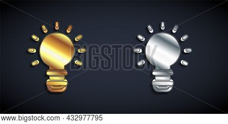 Gold And Silver Creative Lamp Light Idea Icon Isolated On Black Background. Concept Ideas Inspiratio
