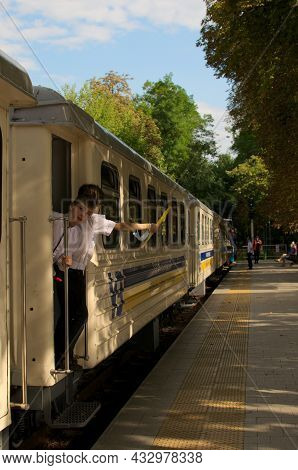 Kyiv, Ukraine-august 22, 2021:Сonductors Hold Yellow Flags. Train Departure Is Allowed. The Station
