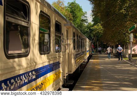 Kyiv, Ukraine-august 22, 2021:Сonductors Hold Red Flags. Train Dispatch Is Delayed. The Stationmaste