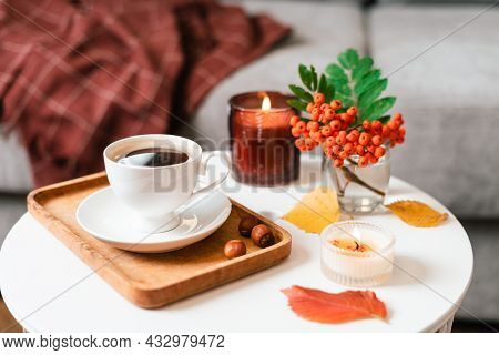 Still Life Book, Candle, Rowan Berry And A Cup Of Tea Or Coffee In The Living Room On A Table, Home