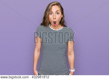 Young blonde woman wearing casual clothes afraid and shocked with surprise expression, fear and excited face.