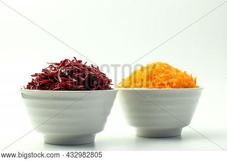 Grated Carrot And Grated Beetroot In The White Bowl, White Background. Selective Focus. Side View.