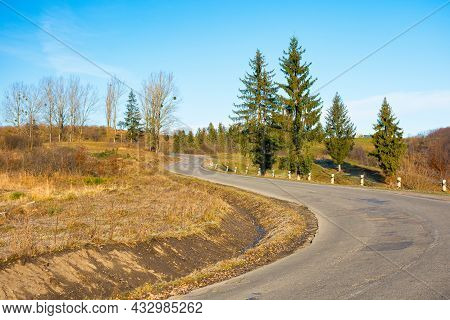 Pass Through Carpathian Mountains. Trees Along The Road Descending In To The Valley Of Volovets, Ukr