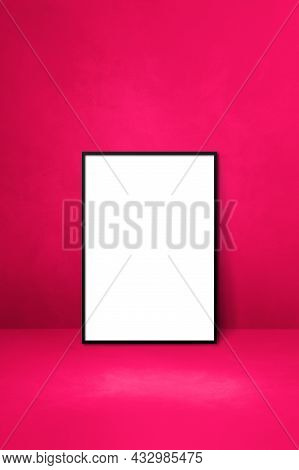 Black Picture Frame Leaning On A Pink Wall. Blank Mockup Template
