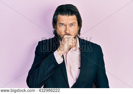 Middle age caucasian man wearing business clothes feeling unwell and coughing as symptom for cold or bronchitis. health care concept.
