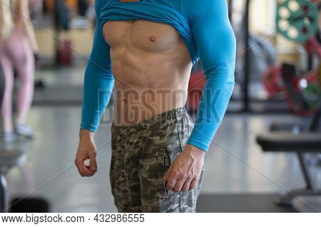The Body Of A Man Of An Athletic Physique Close-up.