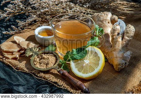 Hot Ginger Juice With Lemon And Mint, Root And Slices Of Ginger Served With Brown Sugar And Honey On