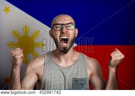 Emotions Of Anger And Indignation. The Man In Glasses Clenched His Hands Into Fists And Shouted. In