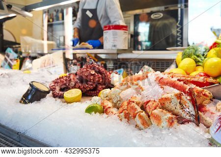 Counter With Frozen Seafood In Ice, In The Store Octopus And Crab