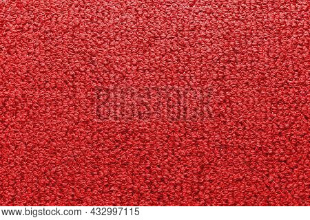 Factory Fabric Of Red Color . Close-up Long And Wide Texture Of Natural Red Fabric. Fabric Texture O