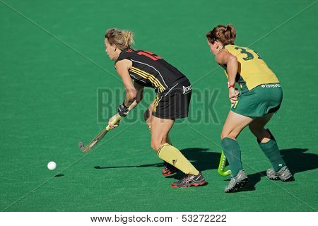 BLOEMFONTEIN, SOUTH AFRICA - FEBRUARY 7: Charlotte de Vos (L) and Celia Evens (R) during a women's field hockey match between South Africa and Belgium, Bloemfontein, South Africa, 7 February 2011
