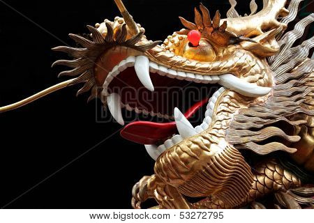 Colorful Chinese dragon with open mounth against a black background