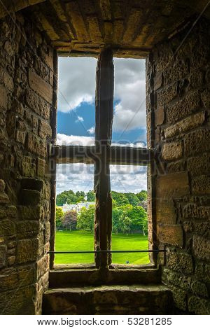 Old window with view to the garden