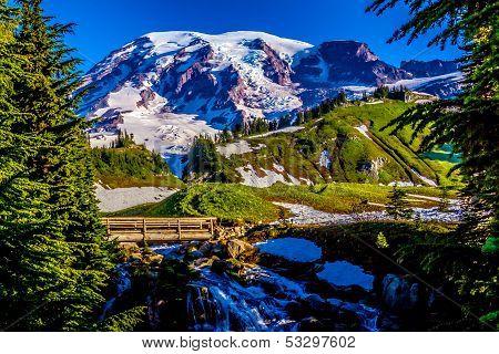 Stream and Bridge on Snow-Capped Mount Rainier, Washington