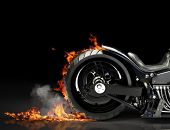 Custom motorcycle burnout on a black background. Room for text or copy space poster