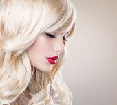 Beauty Blonde Woman Portrait. Beautiful  Blond Girl with Healthy Long Wavy Hair. White Hair. Hairstyle. Beauty Sexy Model. Perfect Skin and Make up. Pretty Face. Hair Extensions poster