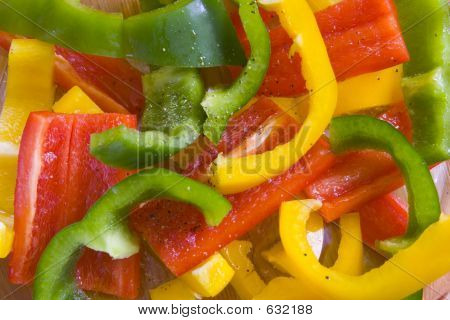 Yellow, Red And Green Sliced Peppers.