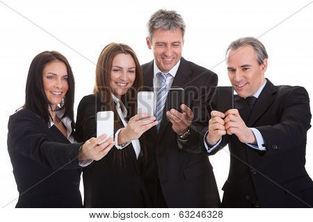Business People Looking At Cell Phones
