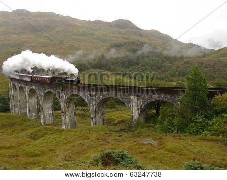 Steam train on Glenfinnan viaduct.