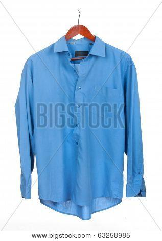 Blue shirt on hanger isolated on white
