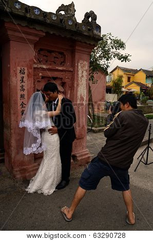 Vietnamese bride and groom posing for wedding photos