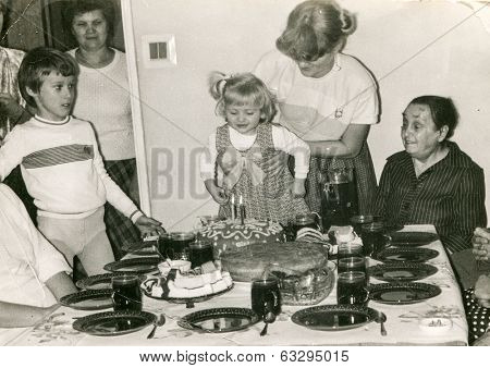 LODZ, POLAND CIRCA 1970's: Vintage photo of family enjoying a family party (child birthday)