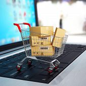 E-commerce. Shopping cart with cardboard boxes on laptop. 3d poster