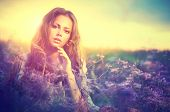 Beauty Girl Portrait. Sensual Woman Lying on a Meadow with Violet Flowers. Beautiful Woman Enjoying Nature. Romantic beauty in fantasy lavender field  poster