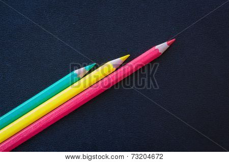 Different Color Pencils Sharpened On Dark Background