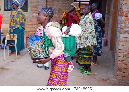A Mother With Her Child In A Traditional African Cloth - Tanzania - Africa