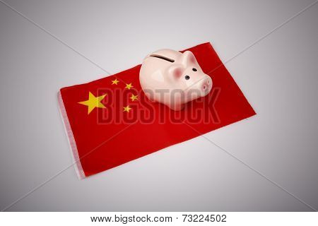 Pig Money Box And China Flag