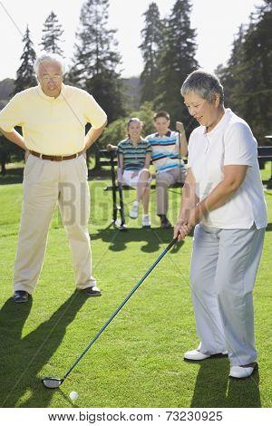 Senior Asian woman playing golf