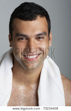 Hispanic man with towel around neck