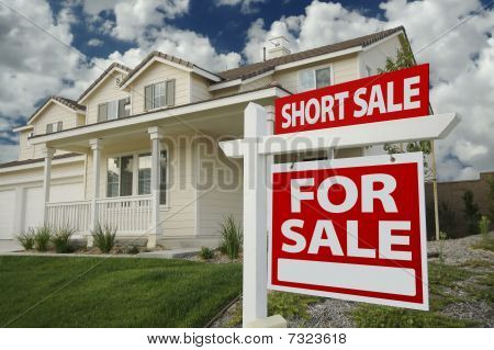 Short Sale Home For Sale Sign And House