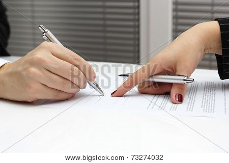 Businesswoman Point With Finger On Paper To Sign Up Contract