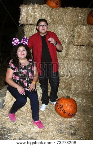 LOS ANGELES - OCT 4:  Raini Rodriguez, Rico Rodriguez at the RISE of the Jack O'Lanterns at Descanso Gardens on October 4, 2014 in La Canada Flintridge, CA