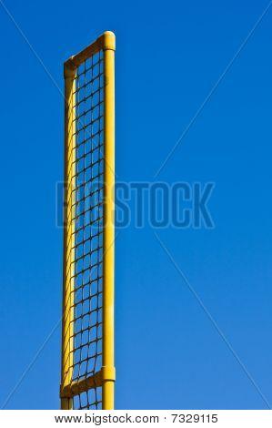 Yellow Foul Pole Against Blue Sky