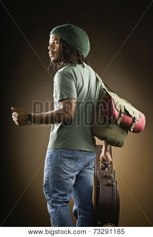 African man with guitar hitchhiking
