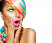 Beauty Surprised Woman Portrait with Colorful Makeup, Hair, Nail polish and Accessories. Colourful Studio Shot of Funny Model Girl. Vivid Colors. Manicure and Hairstyle. Rainbow Colors poster